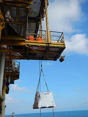 40 metre lift of the replacement diesel engine utilising an air operated hoist.