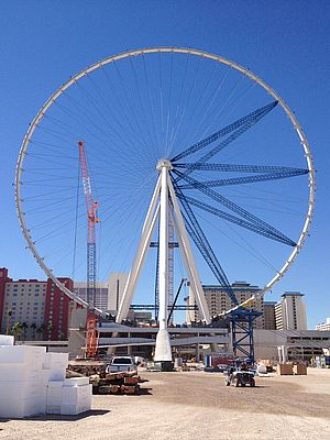 The Las Vegas High Roller observation wheel under construction, showing the outer rim completed with final radial spokes to be added before removal of the temporary radial struts.