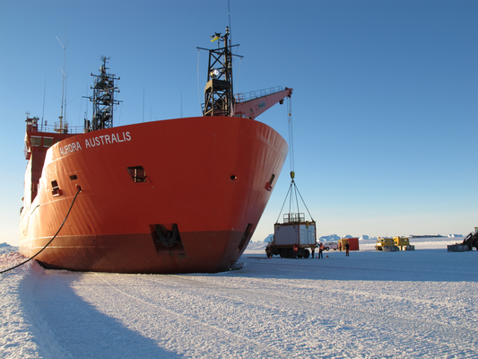 "Unloading of the mobile LIDAR onto the fast ice in front of the Australian Antarctic station Davis (69° S) from the ice breaker ""Aurora Australis"""