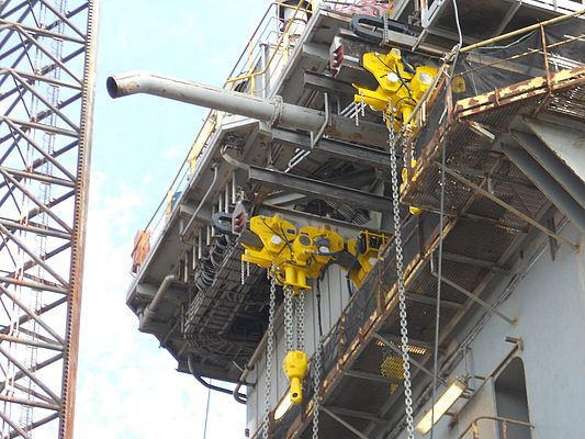 BOP handling air operated hoists being mounted on the Maersk offshore rig Guardian.