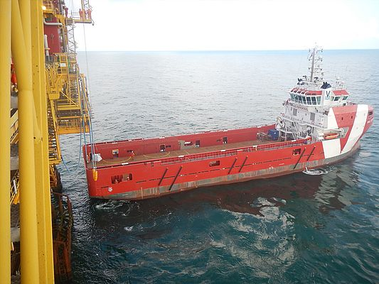 Supply vessel delivering a 2TI hoist and the replacement diesel engine to the offshore platform.