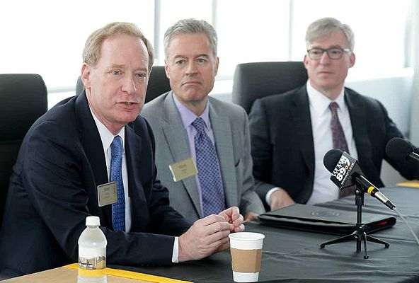 Microsoft president Brad Smith (from left) and University of Wisconsin-Milwaukee chancellor Mark Mone, with Rockwell Automation CEO Blake Moret, announced a $1.25 million gift to support the school's investment in smart technology