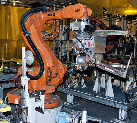 An RSP swivel tool changer STC350SWP with a spot welding gun on an ABB robot in operation at the floor assembly line of the Volvo C70