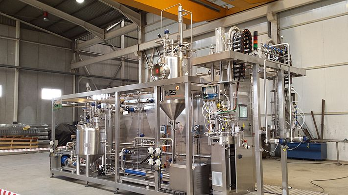 The HRS Aseptic Block Series is a packaged steriliser (or pasteuriser) and aseptic filler